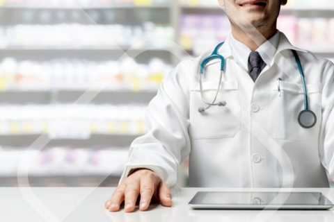 pharmacist in work on laptop using bespoke software application